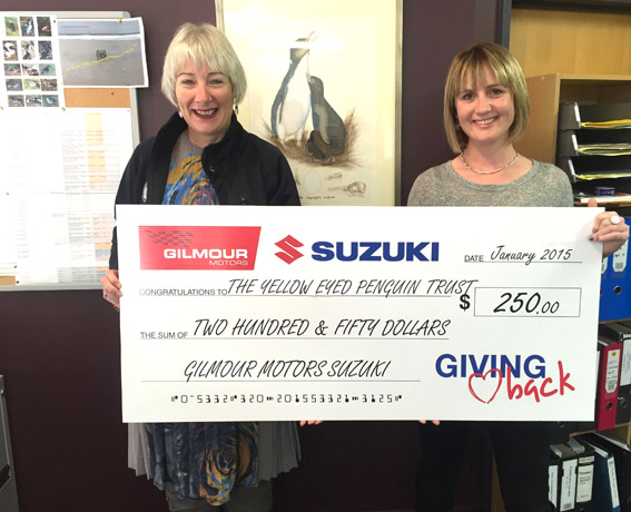 Emma Gilmour presents Sue Murray of the Yellow Eyed Penguin Trust a cheque for $250