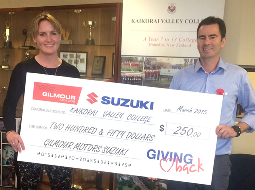 Bevan Ingram accepts the March Giving Back cheque on behalf of Kaikorai Valley College